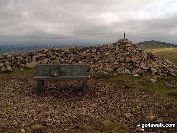 The cairn and bench on the summit of High Pike (Caldbeck)