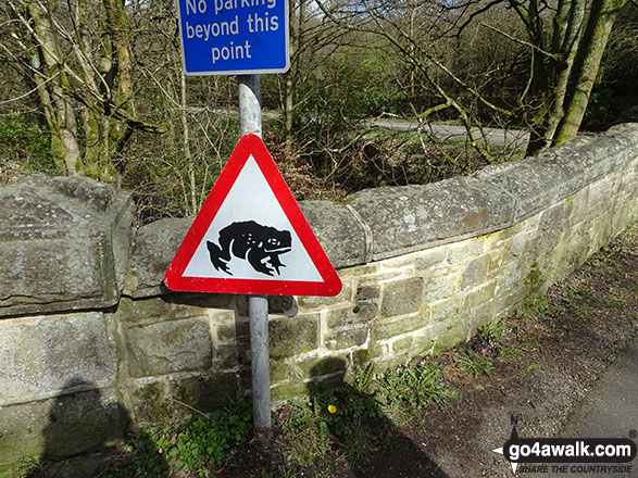 'Caution: Toads Crossing' sign on the road near Bowden Bridge, Hayfield