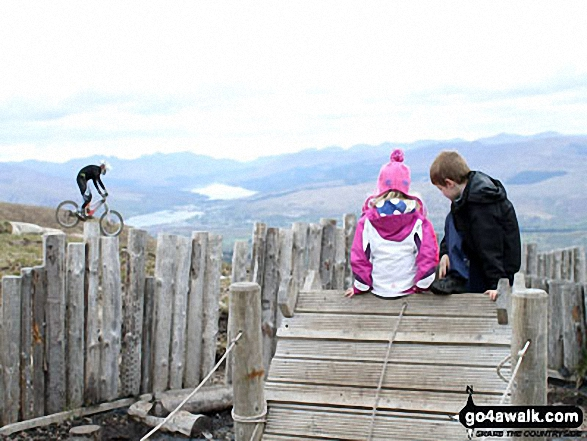 My little girl and her cousin watching the mountain bikers at the top of the Ski lift about half-way up Aonach Mor