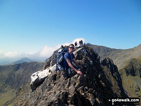 Russ on the top of Crib Goch. Walk route map gw136 The Snowdon (Yr Wyddfa) Horseshoe from Pen y Pass photo