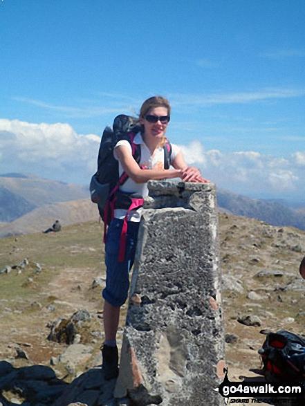 Clare on the summit of Garnedd Ugain (Crib y Ddysgl). Walk route map gw186 Snowdon and Moel Cynghorion from Llanberis photo