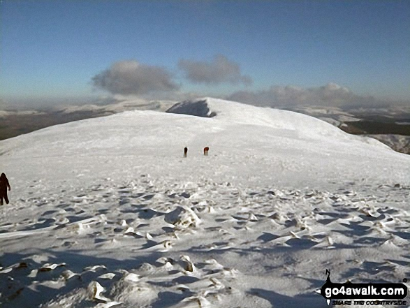 Mynydd Moel from the summit of Cadair Idris (Penygadair) in deep snow. Walk route map gw103 Cadair Idris (Penygadair), Cyfrwy and Gau Graig via The Minffordd Path photo