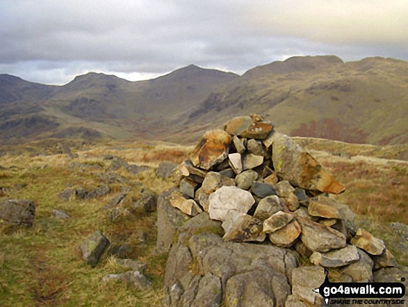 Hard Knott summit cairn - with Esk Pike, Bow Fell (Bowfell) and Crinkle Crags gracing the skyline