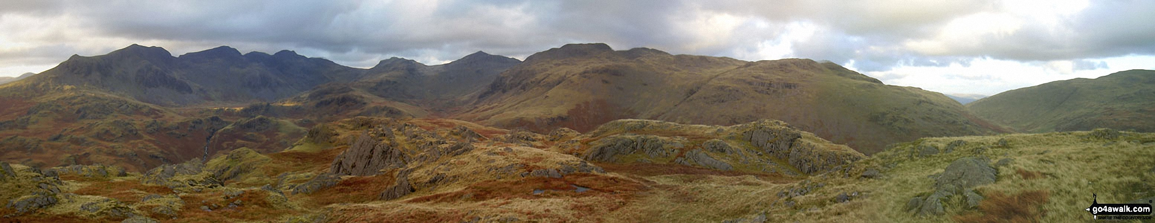From left to right: Slight Side and Sca Fell, Mickledore, Scafell Pike, Ill Crag and Great End, Esk Hause, Esk Pike, Bow Fell (Bowfell), Crinkle Crags (Long Top), Cold Pike, Little Stand and finally the shoulder of Grey Friar from the summit of Hard Knott
