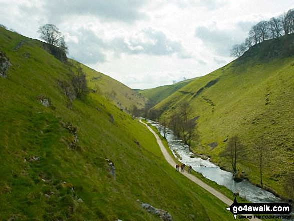 Walkers beside the River Dove in Wolfscote Dale