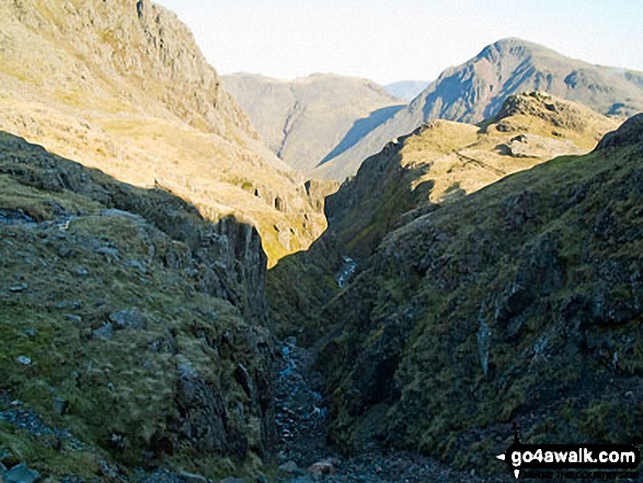 Piers Gill with Lingmell (near left) and Kirk Fell (centre) and Great Gable (right) on the horizon. Walk route map c454 Scafell Pike via The Corridor Route from Seathwaite photo