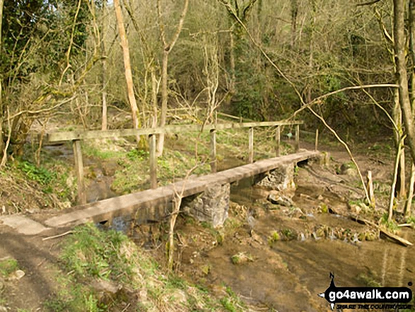The footbridge at the Miller's Dale end of Monk's Dale. Walk route map d163 Tideswell and The Monsal Trail from Peak Forest photo