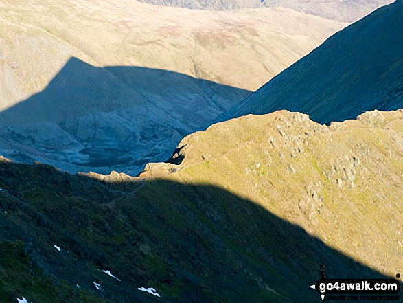 Walkers on Swirral Edge from the summit of Helvellyn. Walk route map c192 Helvellyn Ridge from Glenridding photo