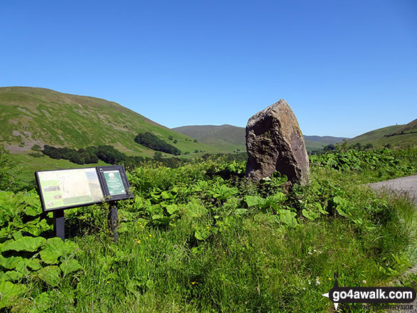 The large stone and information board mark the layby at Hause Bridge