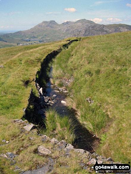Moelwyn Bach, Craigysgafn and Moelwyn Mawr beyond the water leat on Moel Bowydd