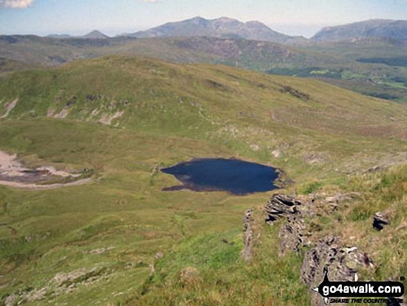 Llynnau Barlwyd (foreground), Moel Farlwyd (midground left), Yr Aran (pointed peak above Moel Farlwyd), Mount Snowdon (Yr Wyddfa) & Y Lliwedd from Moel Penamnen