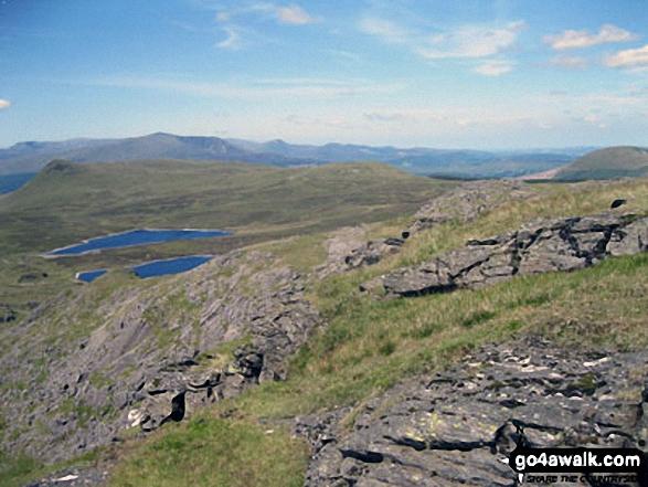 The Carneddau & Carnedd Moel Siabod (on horizon), Moel Penamnen (left) and Llyn Newydd & Llyn Bowydd (mid distance ) from Manod Mawr (North Top)