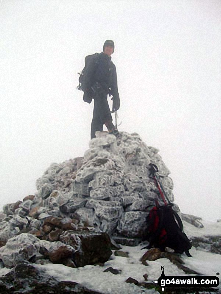 A the summit of a snowy Wetherlam