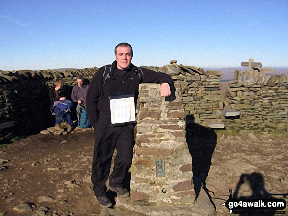 On the summit of Pen-y-ghent during The Yorkshire Three Peaks Challenge
