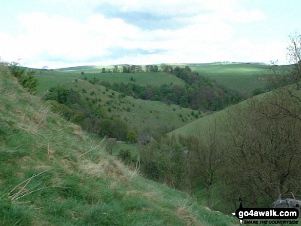 Descent into Milldale from Stanshope. Walk route map s111 Dove Dale, Ilam, Castern Hall and Stanshope from Milldale photo