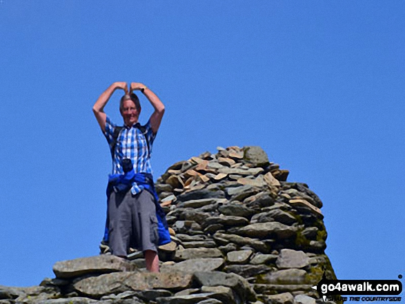Doing the 'Mobot' on the summit of The Old Man of Coniston