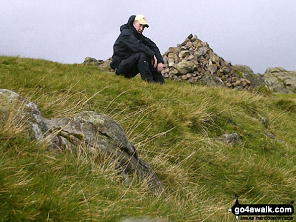 Walk c428 The Langdale Pikes, High Raise and The Easedale Fells  from Grasmere - Me beside a very wet Silver How Summit cairn
