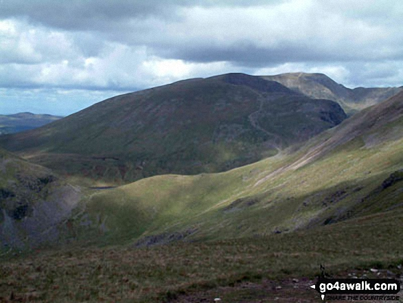 Grisedale Hause, Dollywaggon Pike (centre), Nethermost Pike, Helvellyn and Striding Edge (far right) from Great Rigg. Walk route map c247 The Fairfield Horseshoe from Ambleside photo