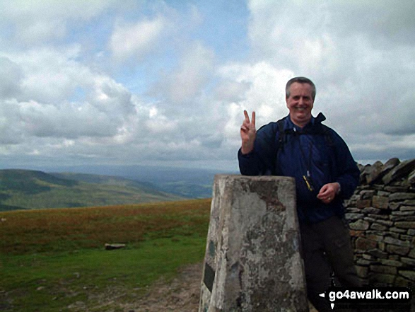 On Whernside summit during The Yorkshire Three Peaks Challenge. Walk route map ny101 The Yorkshire Three Peaks from Horton in Ribblesdale (New 2013 Route) photo