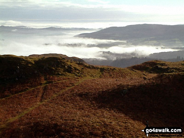 Mist over Windermere from Loughrigg Fell summit