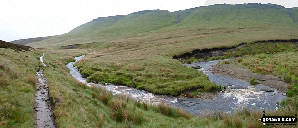 The River Ashop in Ashop Clough with The Kinder Scout Plateau above
