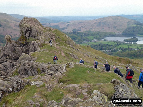 Runaway Ramblers from Bury approach 'The Lion and the Lamb' on Helm Crag