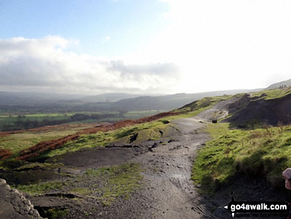 Walking towards Mam Tor on land slipped road. Walk route map d229 Mam Tor from Edale photo