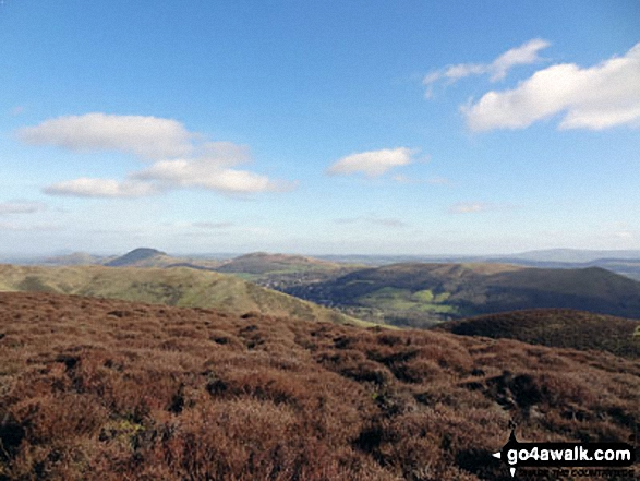 The Lawley (left), Caer Caradoc Hill, Church Stretton, Ragleth Hill (right) with Yearlet and Ashlet  in the mid-distance from near Grindle above Ashes Hollow