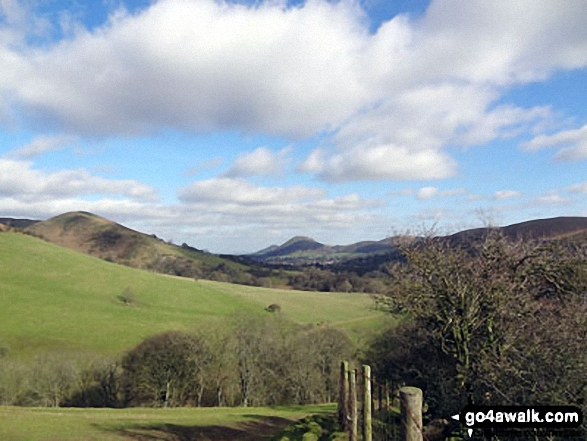 Nills (left) and Church Stretton with The Lawley and Caer Caradoc Hill beyond from near Minton