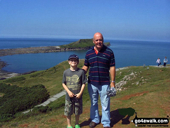 My husband and son on top of Worms Head/Penrhyn-Gwyr It was beautiful up there!! :o)