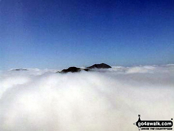 The summits of Ben Vane (left) and Beinn Ime poking up through the clouds during a temperature inversion seen from Ben Vorlich (The Arrochar Alps)