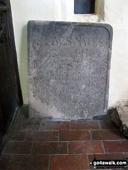 Ancient gravestone inside St. Bartholomew's Church, Blore