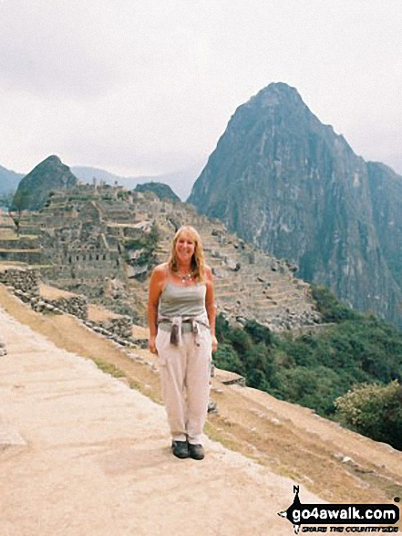 A very happy me on Machu Picchu with Wayna Picchu in the background walk The Andes  Peru walks