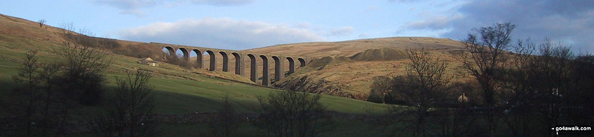The Arten Gill Beck railway viaduct and Wold Fell from near Cowgill