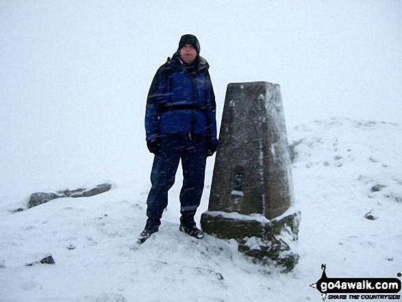 Carl 'Mozzer' Morris on the summit of Winhill Pike (Win Hill) during a blizzard