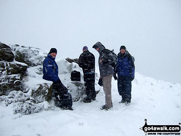 Jimbles, Langy, Big Truck & Mozzer on the summit of Winhill Pike (Win Hill) during a blizzard