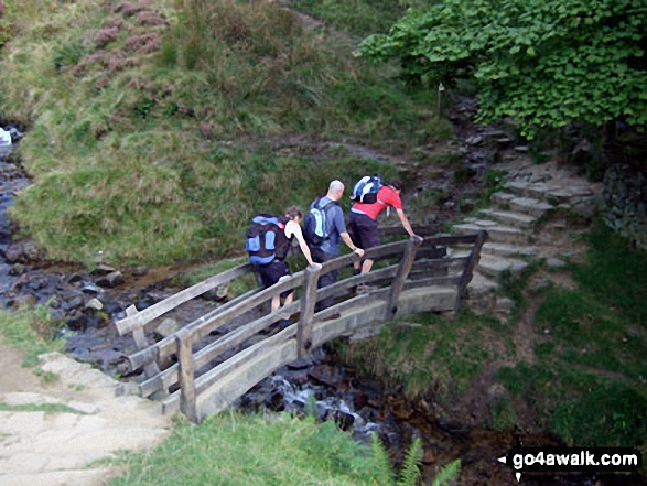 Crossing the footbridge over Grinds Brook near Edale. Walk route map d296 Jacob's Ladder and Kinder Scout from Edale photo