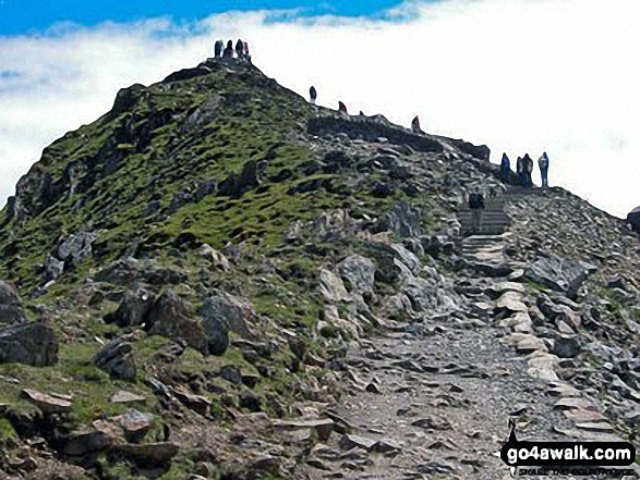 The summit of Snowdon with friends. Walk route map gw134 Mount Snowdon (Yr Wyddfa) avoiding Crib Goch from Pen y Pass photo