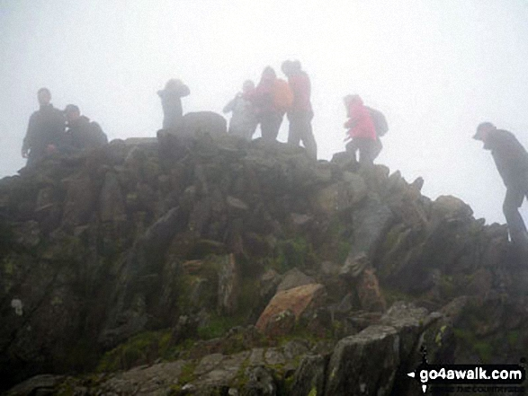 This is a pic of my boyfriend mounting the steps to the summit of Snowdon in rather foggy conditions!. Walk route map gw107 Snowdon and Yr Aran from Rhyd Ddu photo