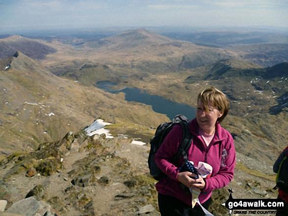 On the summit of Snowdon (Yr Wyddfa) with Crib Goch (left) and Llyn Llydaw (right) in the background. Walk route map gw136 The Snowdon (Yr Wyddfa) Horseshoe from Pen y Pass photo