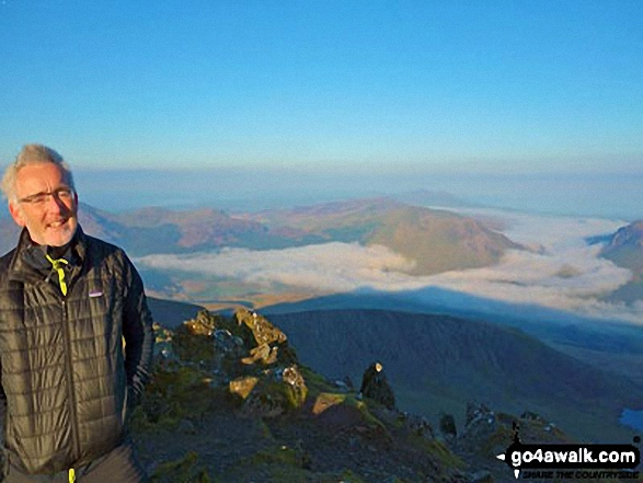 My son in law Mark waking up on the top of Snowdon with fabulous clouds down below