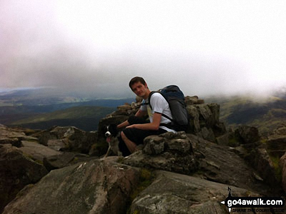 Nick and Jet my dog at the top of Schiehallion