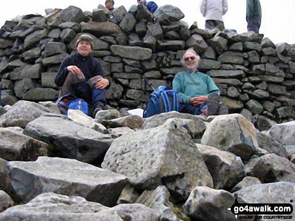 Me and my Dad, having a well earned rest at the top of Scafell Pike having completed all three peaks in the UK National Three Peaks Challenge.. Walk route map c233 Sca Fell and Scafell Pike from Wasdale Head, Wast Water photo