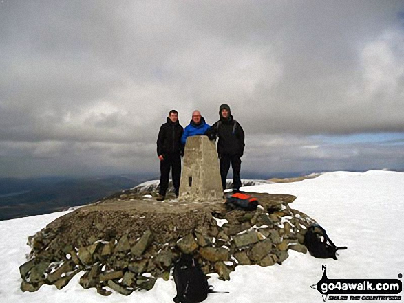 On Ben Nevis summit trig point in the snow. Walk route map h154 Ben Nevis and Carn Mor Dearg from The Nevis Range Mountain Gondola photo