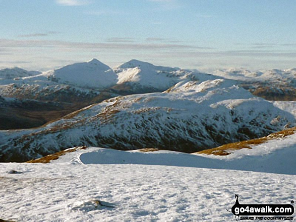 Snow on the distant Stob Binnein and Ben More from Ben Ledi