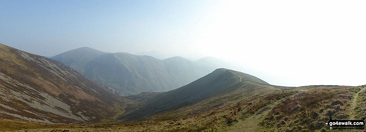 Moel Eilio, Foel Gron and Foel Goch (Snowdon) in the distance with Mynydd Mawr (Llyn Cwellyn) (left), Cwm Planwydd and Foel Rudd (Mynydd Mawr) (right) from Craig y Bera