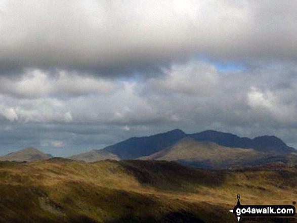 The Snowdon Massif - Yr Aran (far left in sunlight), Snowdon (Yr Wyddfa), Y Lliwedd (in sunlight), Garnedd Ugain (Crib y Ddysgl) and Crib Goch - from Allt-fawr (Moelwyns)