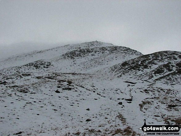 Snow on St Sunday Crag as the mist clears. Walk route map c235 The Deepdale Horseshoe from Patterdale photo