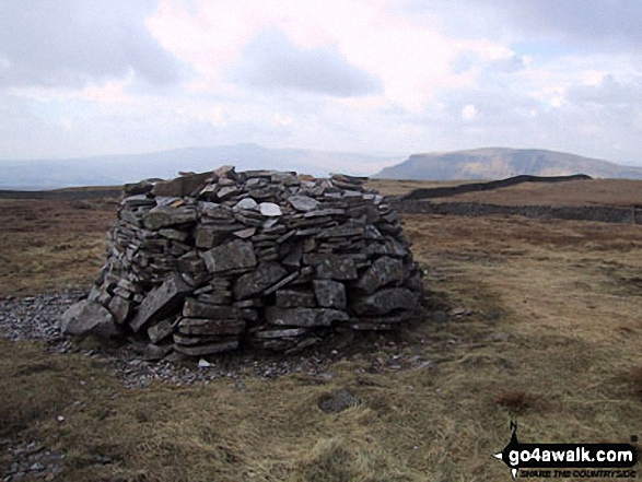 Fountains Fell summit cairn with Pen-y-ghent in the background