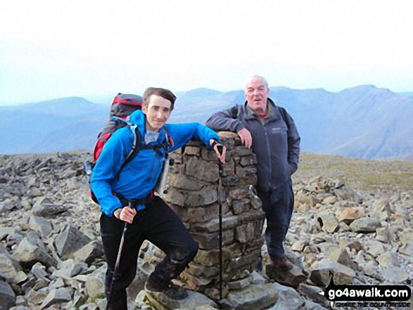Nick & Gerry on a windy day at Scafell Pike summit. Walk route map c111 Scafell Pike from Wasdale Head, Wast Water photo